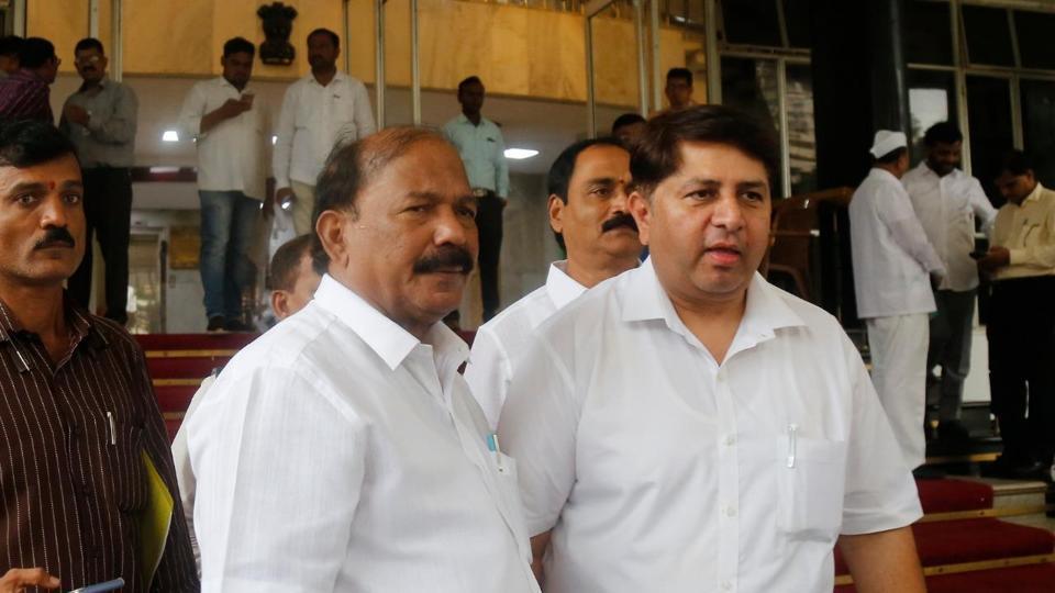 MLA Kalidas Kolambkar (L) and Vaibhav Pichad after submitting resignations.