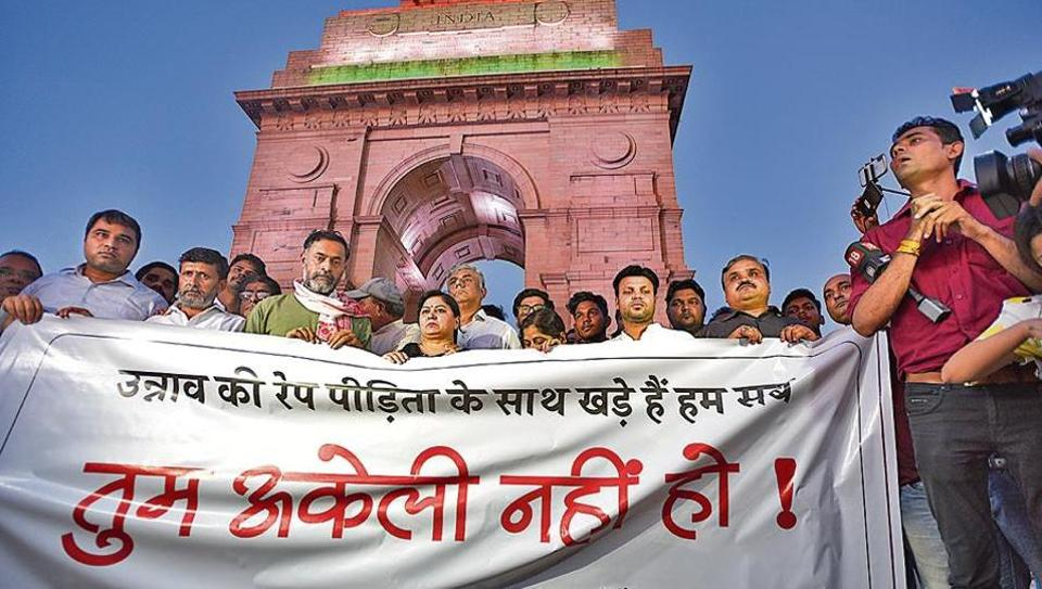 Swaraj Abhiyan leader Yogendra Yadav along with supporters gathered for a silent protest in solidarity with the Unnao rape case victim.