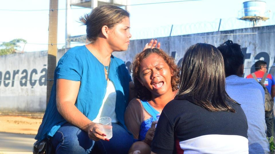 A woman cries after receiving information that her brother was one of the inmates who died during a prison riot, in front of a prison in the city of Altamira, Brazil, July 29, 2019. REUTERS/Bruno Santos