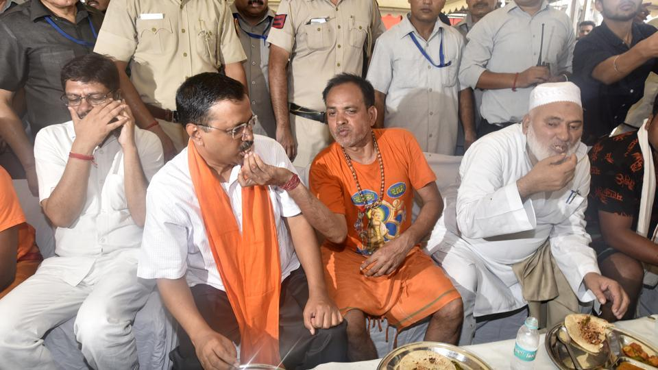 Delhi Chief Minister Arvind Kejriwal eats with yatris during a visit to a Kanwar camp below Dishad Garden Metro Station, in New Delhi, India, on Monday, July 29, 2019.