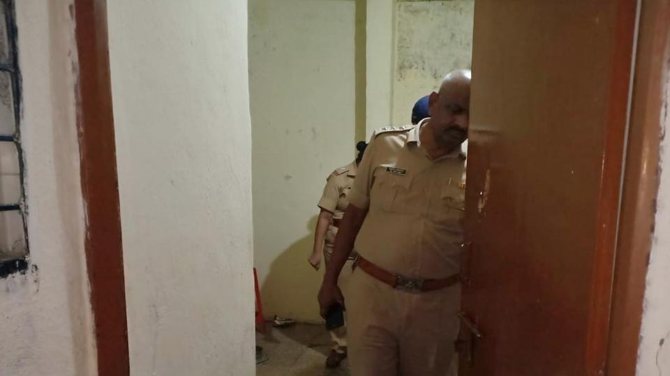 Police inspect the premises in Bhosari where three minors were found dead.