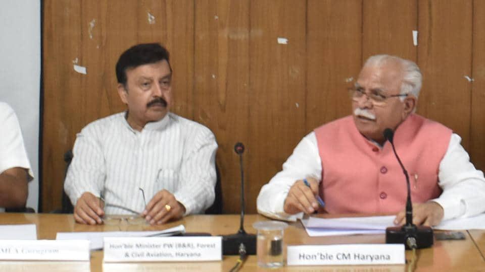 Haryana Chief Minister Manohar Lal Khattar (C) asks for citizen' feedback for poll manifesto.