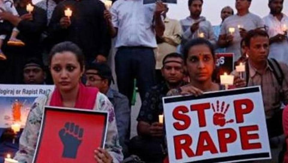 People protest against the rape of a teenager in Unnao, Uttar Pradesh, in Bengaluru, April 13, 2018