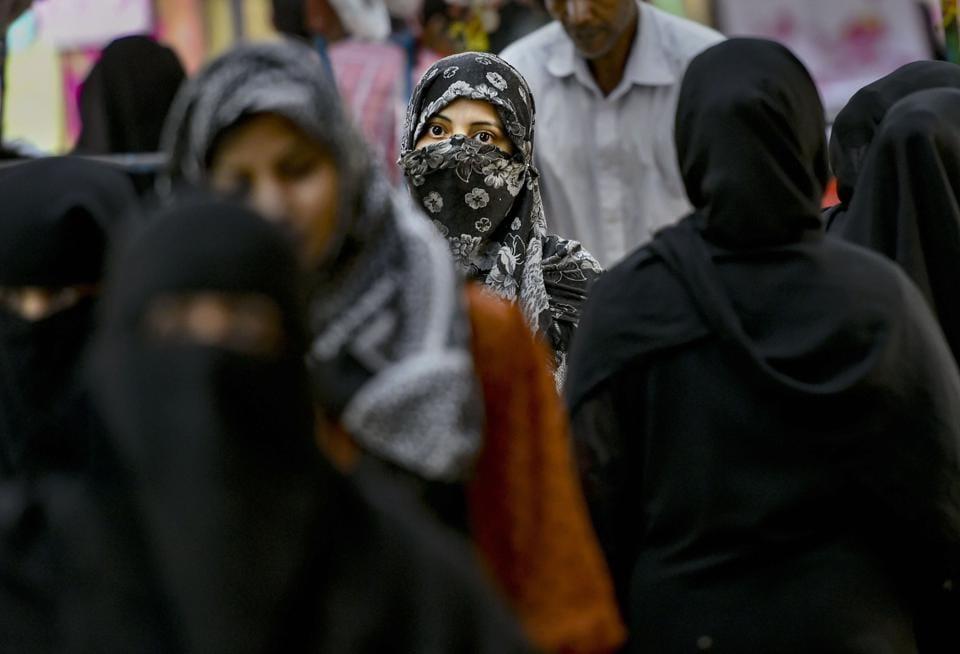 New Delhi: Muslim women walk in a market near Jama Masjid in New Delhi, Thursday, July 25, 2019. The triple talaq bill, passed thrice by the Lok Sabha earlier, cleared its toughest test in the Rajya Sabha on Tuesday, July 30, 2019. (PTI Photo/Arun Sharma)(PTI7_30_2019_000193B)