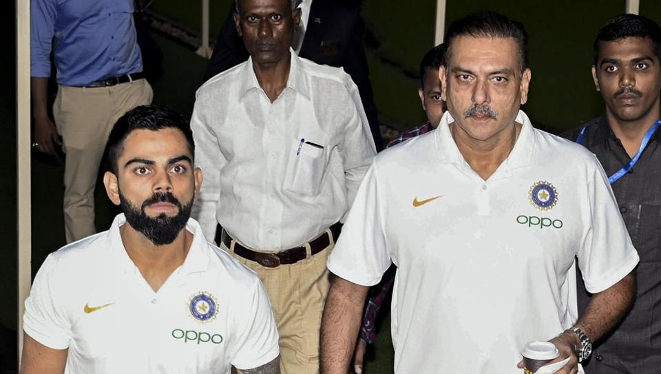 Mumbai: Indian cricket Captain Virat Kohli along with coach Ravi Shastri during a pre-departure press conference in Mumbai