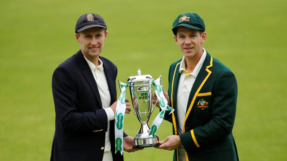 England's Joe Root and Australia's Tim Paine pose with the ashes trophy