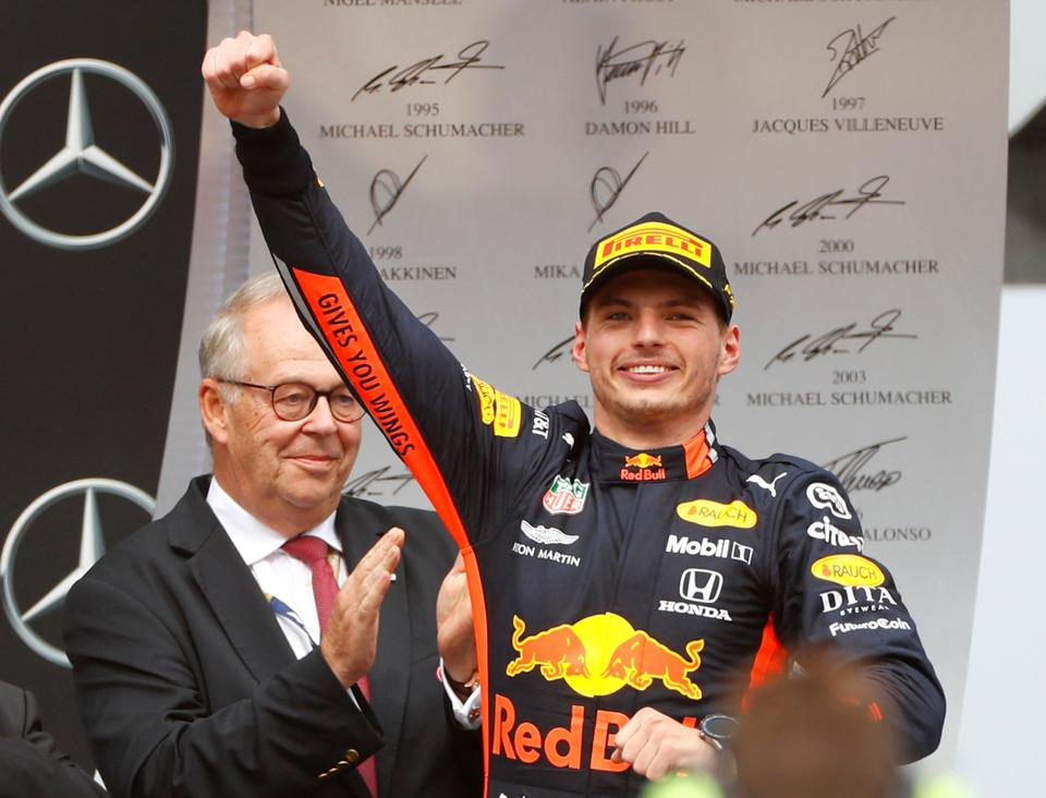 Red Bull's Max Verstappen celebrates on the podium after winning the race in Germany.