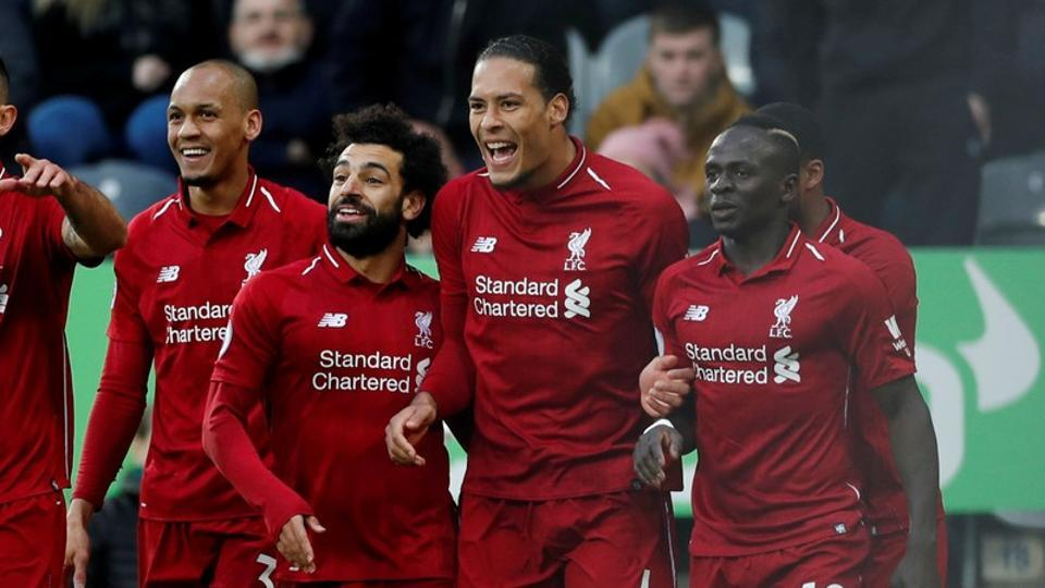 FILE PHOTO of Liverpool's Virgil van Dijk celebrating with Mohamed Salah, Sadio Mane and team mates.