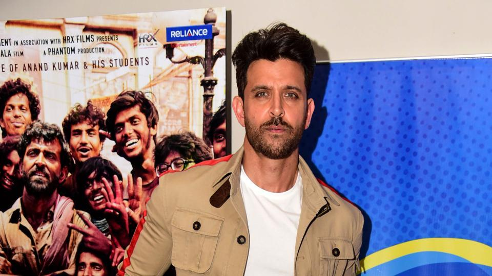 Hrithik Roshan poses for photographs during the promotion of Super 30.