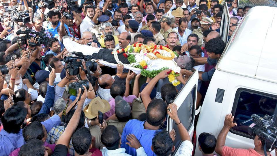 People carry the body of coffee baron V.G. Siddhartha to an ambulance in Mangalore, India, July 31, 2019.