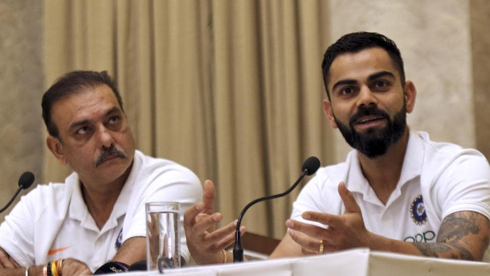 Indian cricket team coach Ravi Shastri, left, looks on as captain Virat Kohli addresses a press conference ahead of the team's departure to West Indies in Mumbai, India, Monday, July 29, 2019.