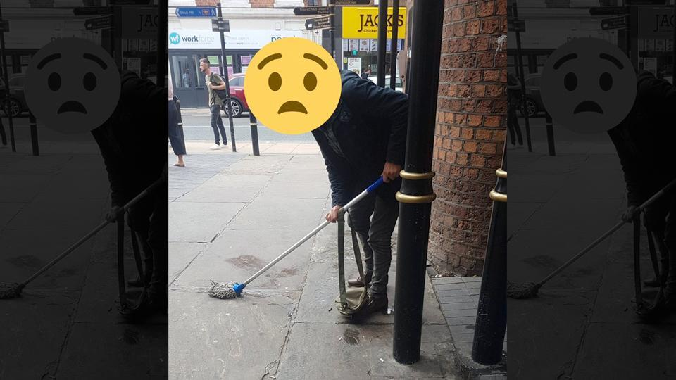 Man was handed a mop and bucket to clean after he pees outside railway station.