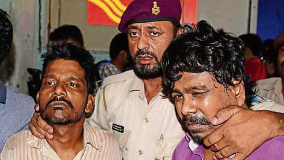 Accused Rinku Sahu and Kailash Kumar (extreme right) after their arrest in Jamshedpur on Wednesday, July 31, 2019.