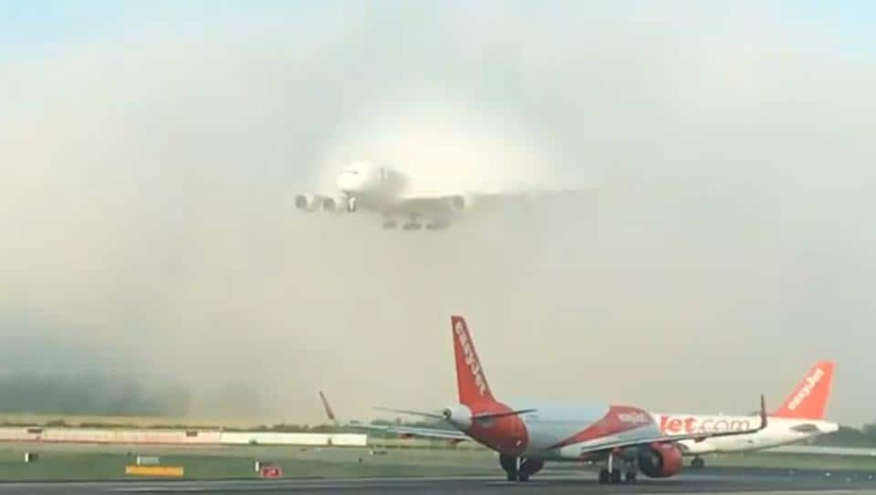 The clip shows the plane emerging out of blanket of clouds and makes for quite the sight.