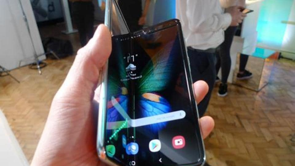 The Samsung Galaxy Fold smartphone is seen during a media preview event in London, Tuesday April 16, 2019. Samsung is hoping the innovation of smartphones with folding screens reinvigorates the market. (AP Photo/Kelvin Chan)