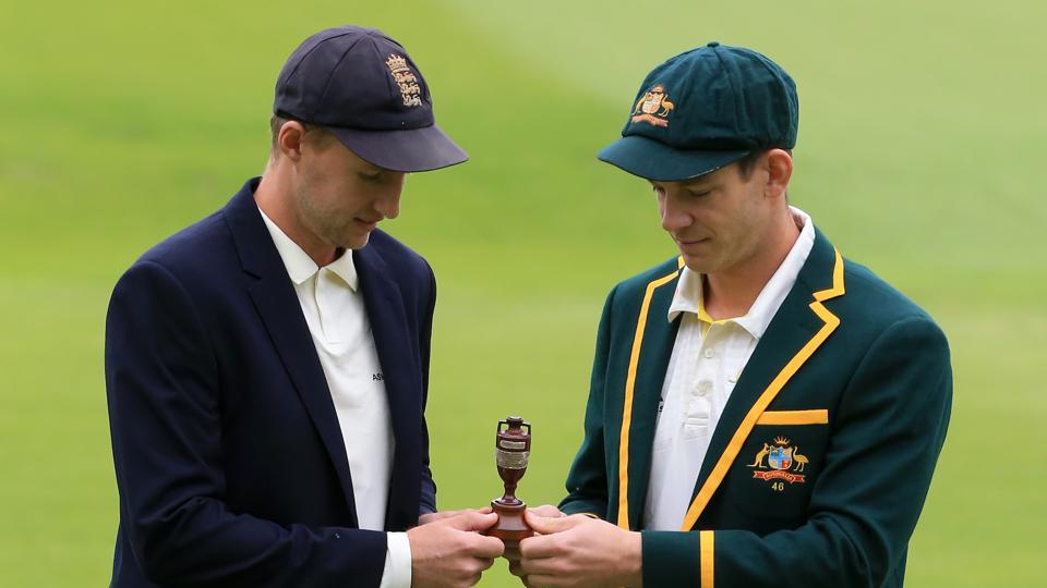 England's captain Joe Root (L) and Australia's captain Tim Paine hold the urn containing the Ashes
