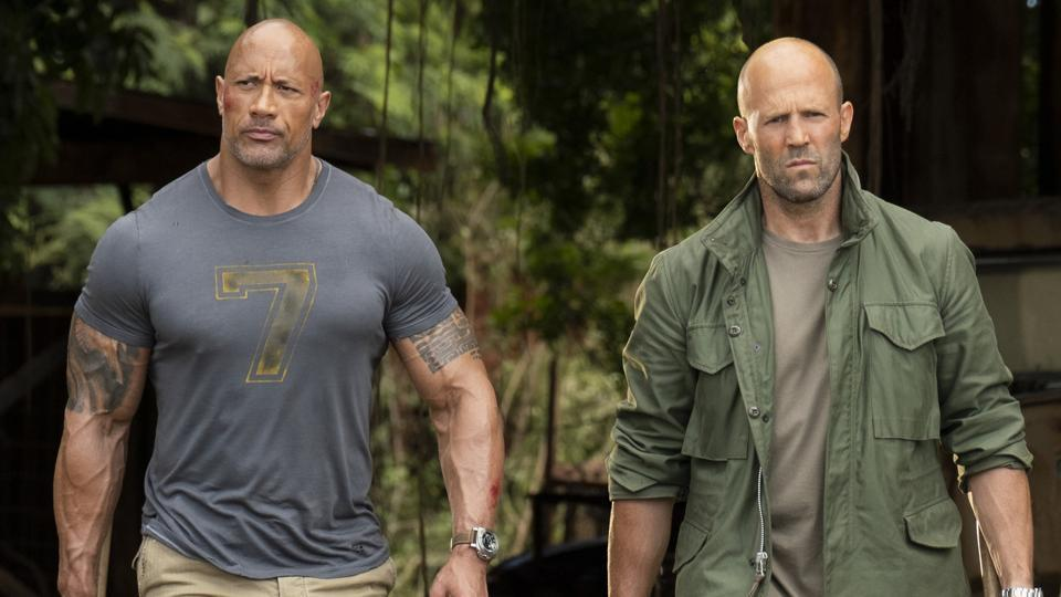 This image released by Universal Pictures shows Dwayne Johnson, left, and Jason Statham in a scene from Fast & Furious Presents: Hobbs & Shaw.