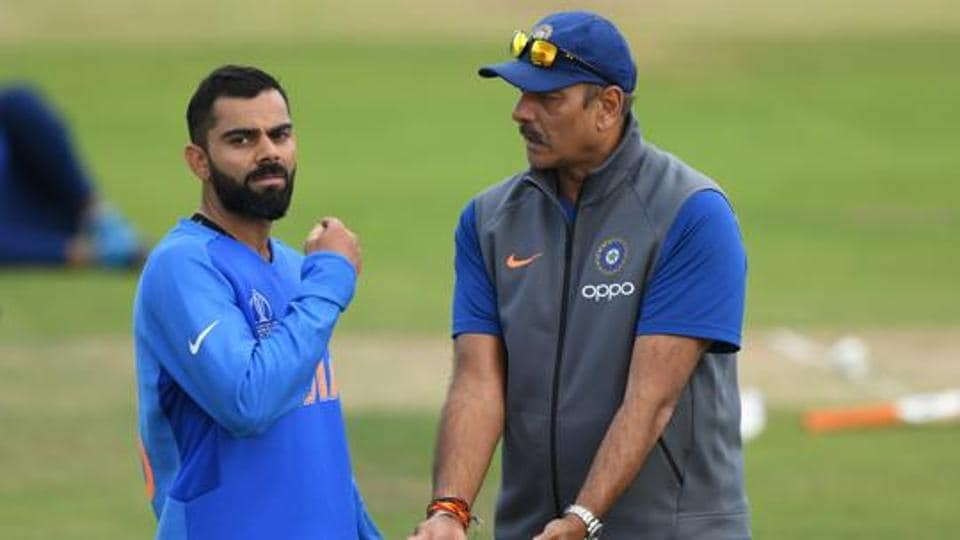 India captain Virat Kohli chats with coach Ravi Shastri during India's practice session