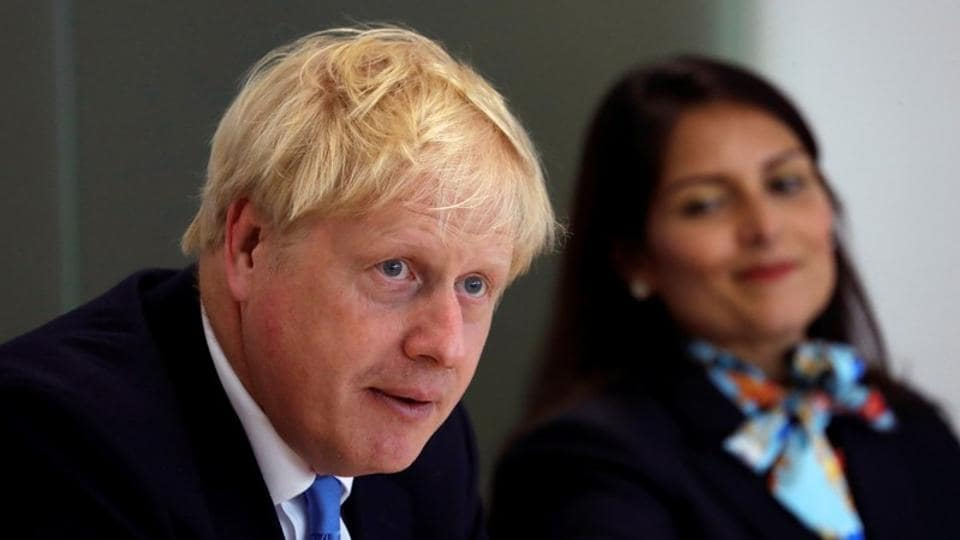 Britain's Prime Minister Boris Johnson speaks alongside Home Secretary Priti Patel during the first meeting of the National Policing Board at the Home Office in London, Britain July 31, 2019.