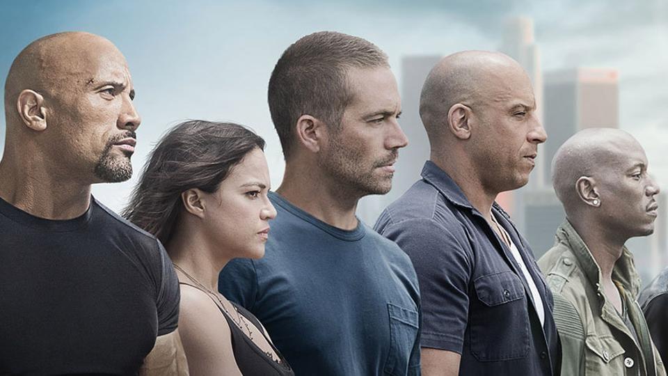 Dwayne Johnson, Michelle Rodriguez, Paul Walker and Vin Diesel in Furious 7.