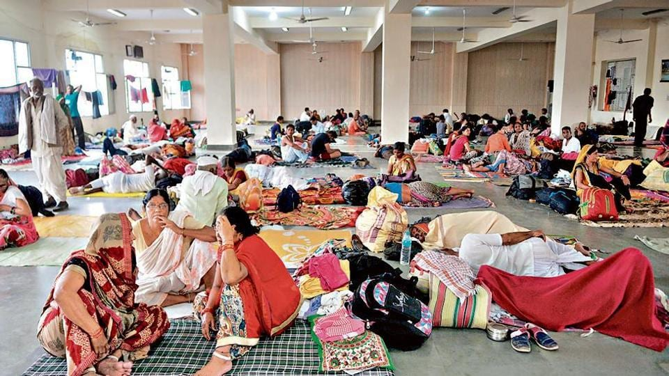 Amaranth pilgrims rest at a base camp in Jammu on Friday.