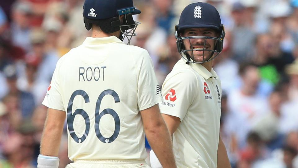 England's captain Joe Root (L) exchanges words with England's Rory Burns.