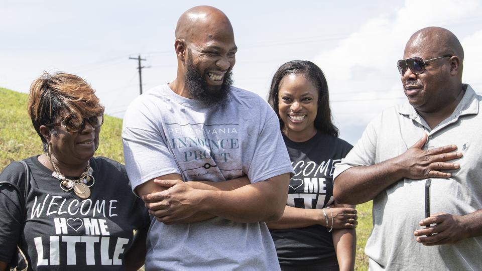 John Miller, center, smiles with his family, Velma Miller, left, mother, Kalita Miller, sister, and brother Lamont Washington, outside the SCI Mahanoy State Correctional Institution in Frackville.