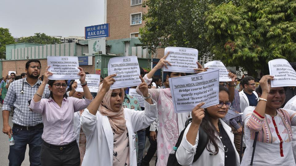 Doctors holding placards shout slogans  against National Medical Commission at the All India Institute of Medical Sciences (AIIMS) in New Delhi.