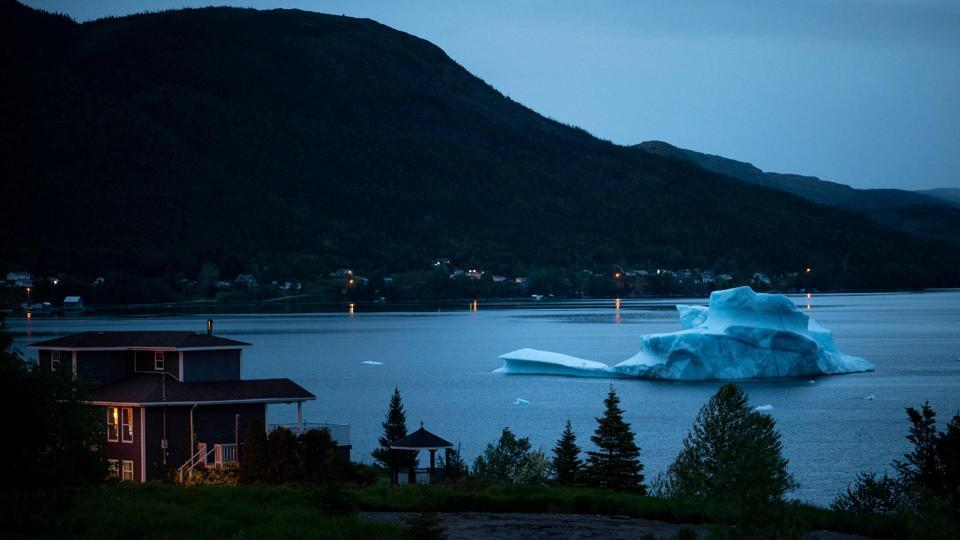 An icebergs swim at the seashore of King's Point on July 4, 2019 in Newfoundland, Canada. Formerly the center of cod fishing, the island province now sees more and more Icebergs that made their last trip from Greenland to Newfoundland.