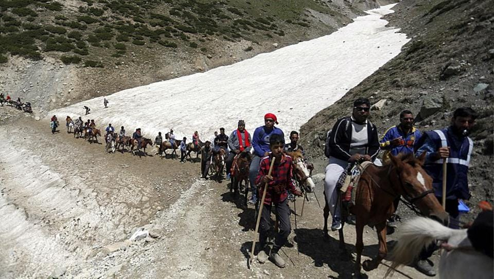 Pilgrims on their way to the holy cave shrine of Amarnath in Kashmir.Three Indian carriers