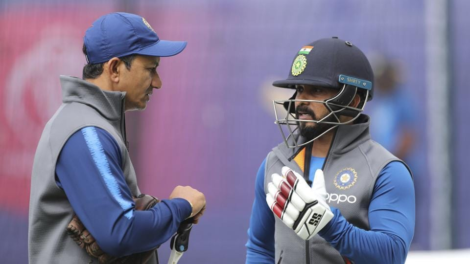 India's Kedar Jadhav speaks to batting coach Sanjay Bangar in the nets at the Cricket World Cup match.