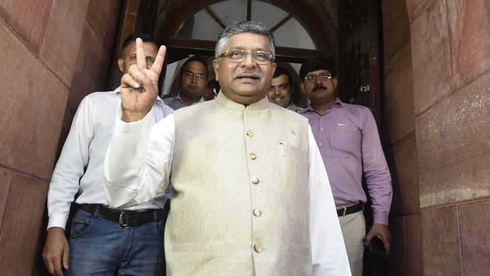 Law minister Ravi Shankar Prasad shows victory sign after Rajya Sabha cleared triple talaq bill, at Parliament House, in New Delhi on Tuesday, July 30, 2019.