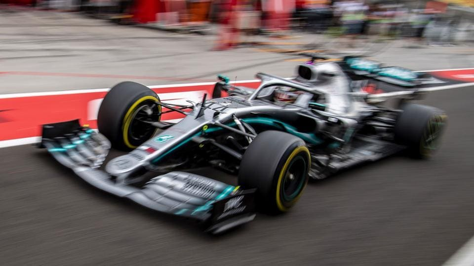 Mercedes' British driver Lewis Hamilton steers his car during the first practice session