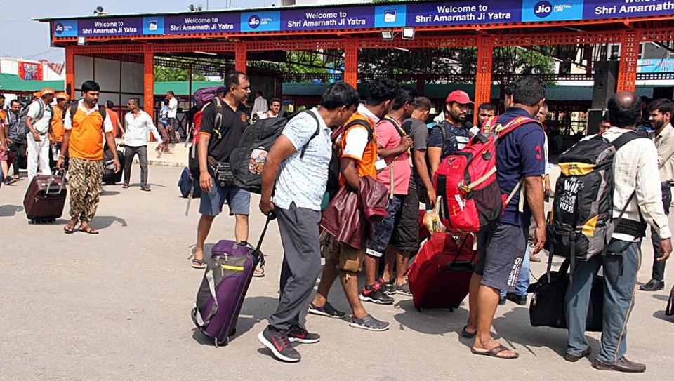 Amarnath Yatra Pilgrims leave as J&K Government announces an advisory to the Amarnath Yatris and tourists to leave the valley as soon as possible, in Srinagar on Saturday.