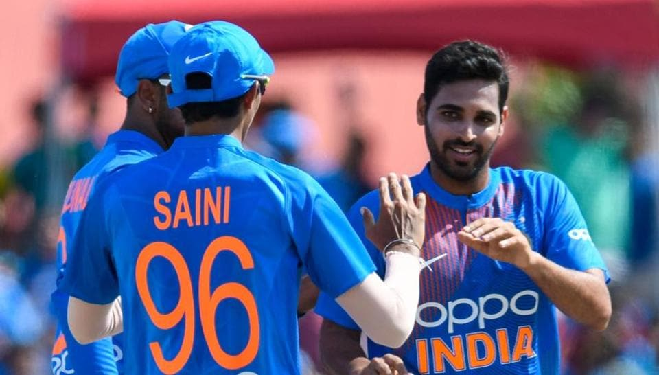 Bhuvneshwar Kumar (R) of India celebrates the dismissal of Evin Lewis of West Indies during the 1st T20i match between West Indies and India at Central Broward Regional Park Stadium in Fort Lauderdale, Florida, on August 3, 2019