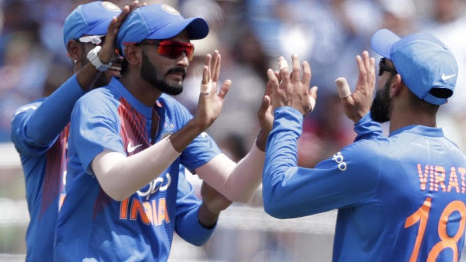 India's Khaleel Ahmed, left, celebrates with with Virat Kohli after taking the wicket of West Indies' Sunil Narine. (AP)