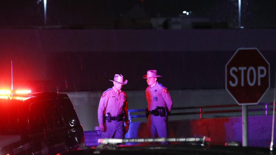 Police keep watch outside Walmart near the scene of a mass shooting which left at least 20 people dead on August 3, 2019 in El Paso, Texas. A 21-year-old male suspect was taken into custody. At least 26 people were wounded.
