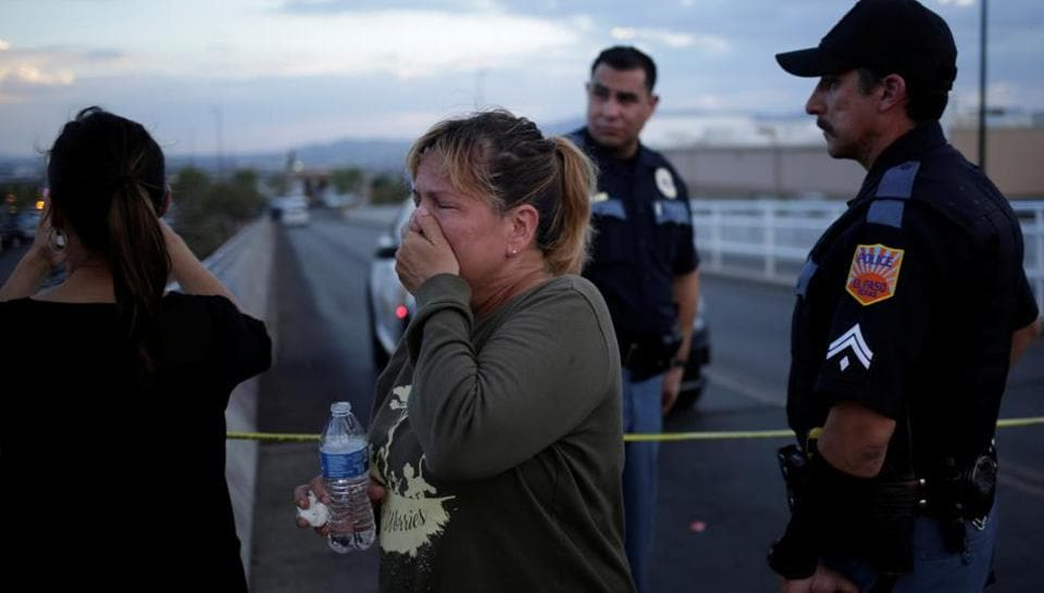 A woman reacts after a mass shooting at a Walmart in El Paso, Texas, U.S. August 3, 2019.