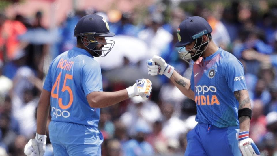 India's Rohit Sharma, left, bumps fist with Virat Kohli, right, during the first Twenty20 international cricket match against the West Indies, Saturday, Aug. 3, 2019, in Lauderhill, Fla. India won by four wickets.