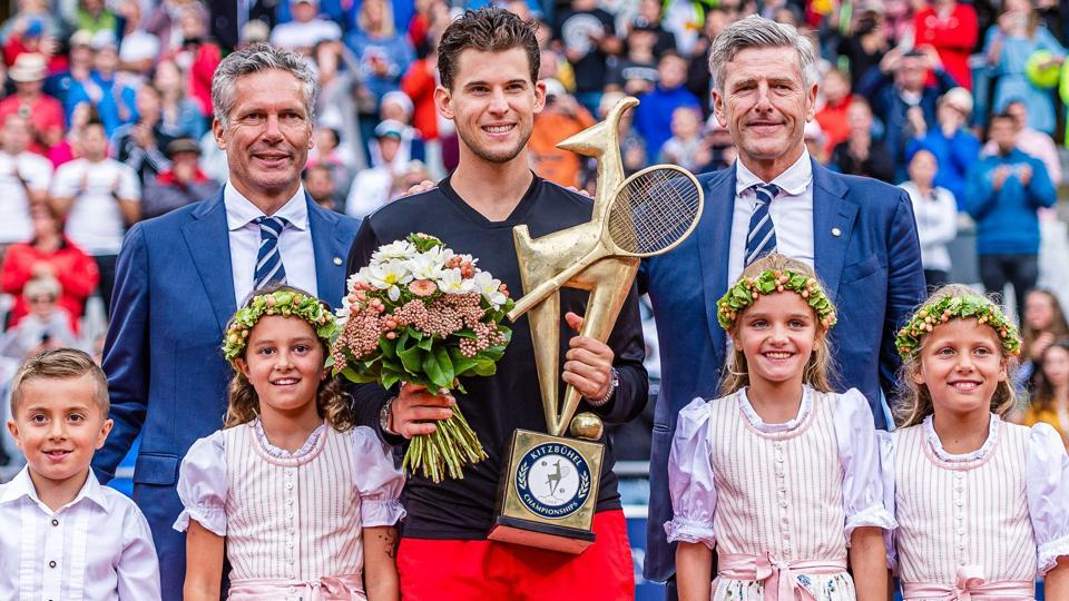 Dominic Thiem of Austria celebrates with the trophy after winning against Albert Ramos-Vinolas of Spain.