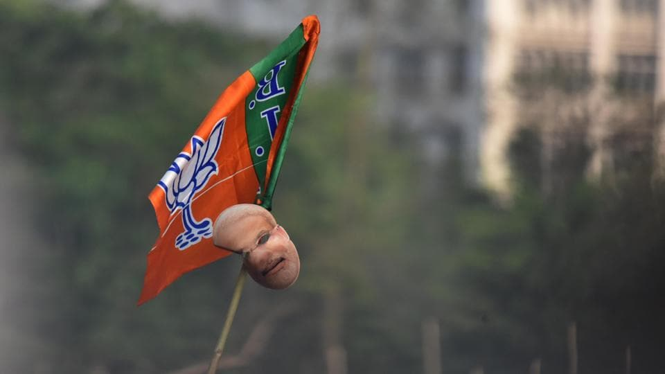 A BJP flag with mask of Prime Minister Narendra Modi seen during his political rally ahead of the Lok Sabha elections, at Brigade Parade Ground, in Kolkata. As it turned out, GDP growth in the quarter ending 31 March 2019 was the lowest under the Narendra Modi government, but this data came out only by the end of May.