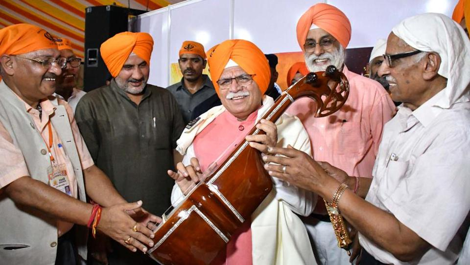 Haryana chief minister Manohar Lal Khattar (centre)and state BJP chief Subhash Barala (2L) at a function ahead of the 550th birth anniversary of Guru Nanak Dev in Sirsa on Sunday