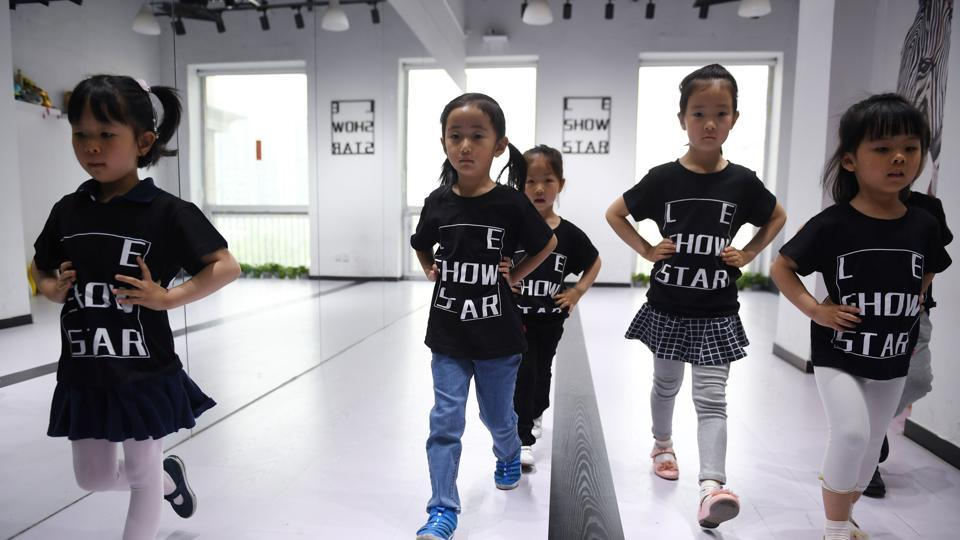 Children training at a modelling school in Beijing.