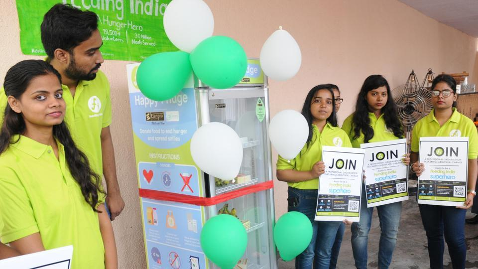 College students after installation of a refrigerator to store food for poors and needy in the premises of a banquet hall at Harmu colony in Ranchi, India, on Sunday, August 4, 2019.