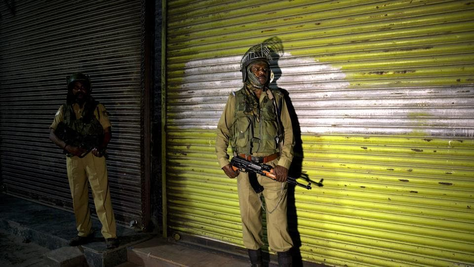 Indian soldiers stand guard in the night in Srinagar, India, Sunday, Aug. 4, 2019. Authorities have decided to impose restrictions across the Kashmir Valley from early Monday morning.