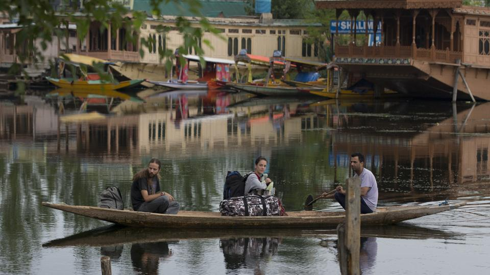 "Foreign tourists cross the Dal Lake on a shikara as they prepare to leave Srinagar. Australia, Germany and the United Kingdom asked their citizens to avoid all travel to Jammu and Kashmir, a day after the government asked tourists and Amarnath Yatra pilgrims to ""immediately"" cut short their stay and return, in an unprecedented advisory amid intelligence inputs of terror threats. (Dar Yasin / AP)"