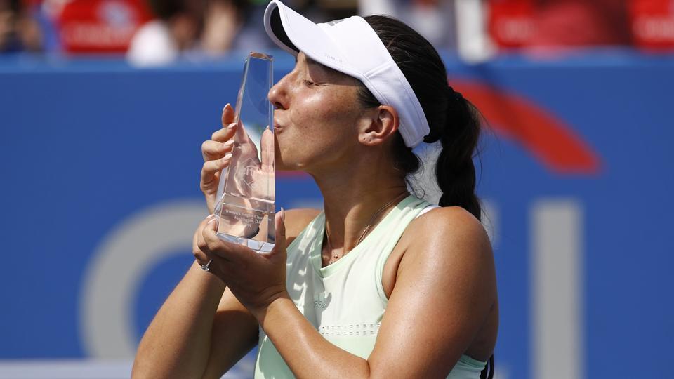 Jessica Pegula poses with a trophy after defeating Camila Giorgi, of Italy.