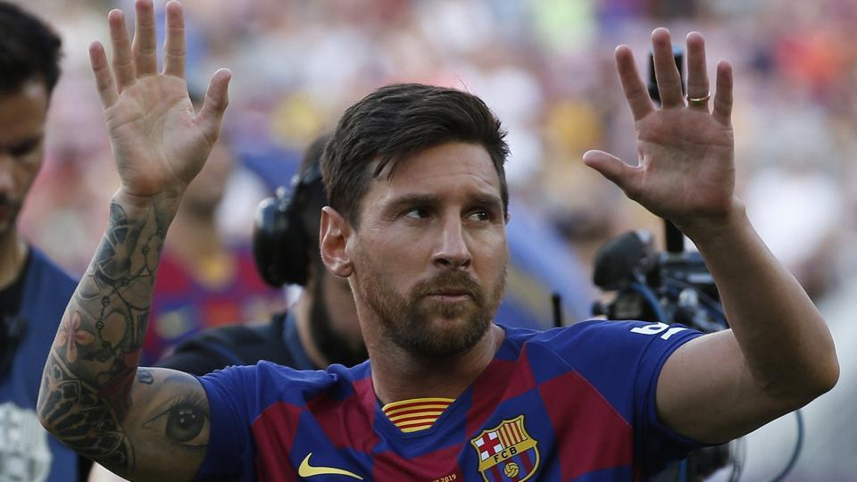 Barcelona forward Lionel Messi waves to the crowd prior of the Joan Gamper trophy.