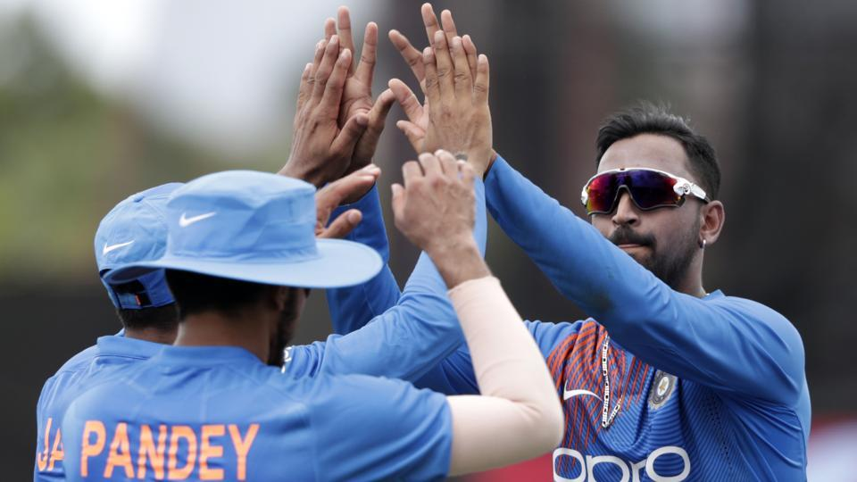 Krunal Pandya celebrates with teammates during the second T20Ibetween India and West Indies.