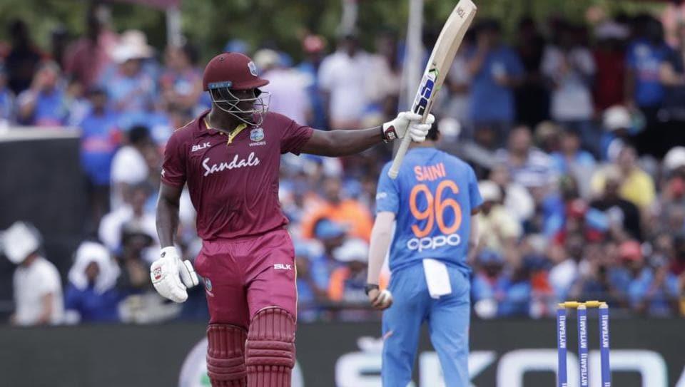 West Indies' Rovman Powell raises his bat after scoring fifty